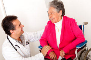medical staff assisting an old woman